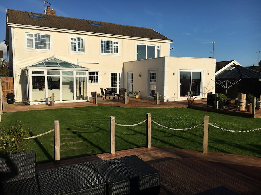 Sunny, private south facing garden, with country and sea views.