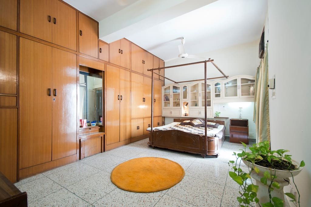 Spacious bedroom 1. Ample space for storage and entrance to a huge balcony.