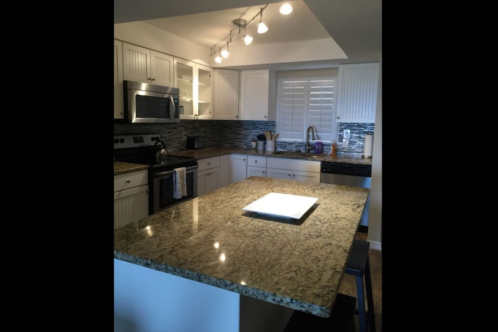 Gorgeous kitchen with stainless steel appliances.
