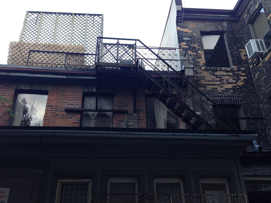 Exterior of the inner courtyard looking up at fire escapes.