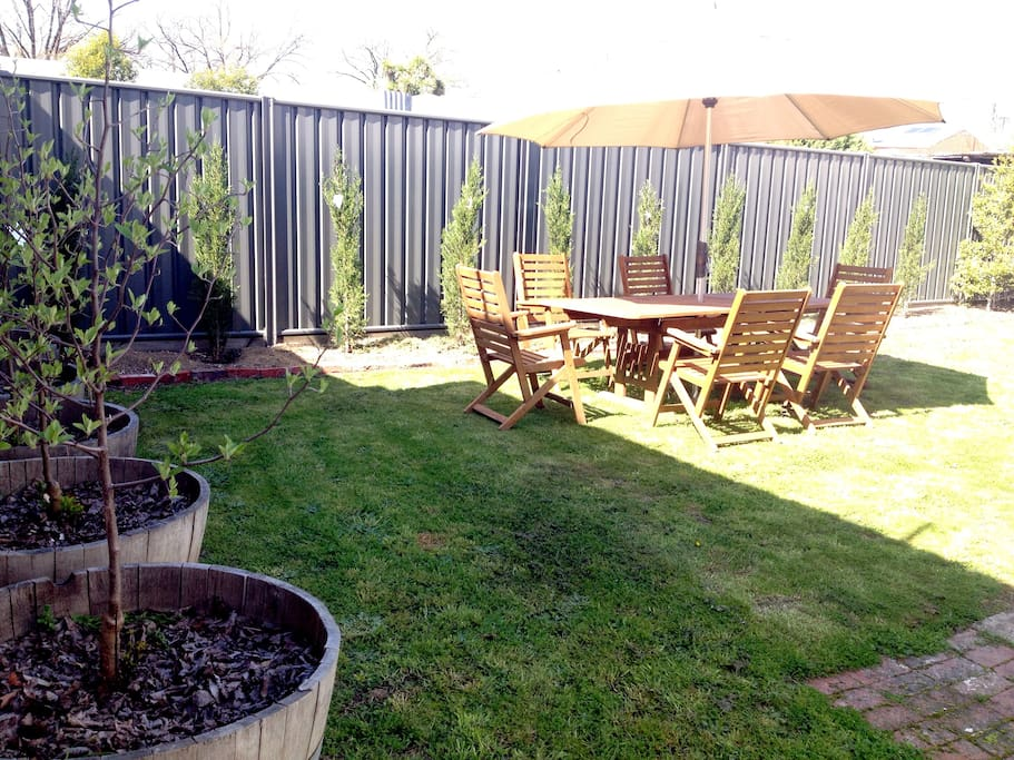 fenced yard and BBQ area.  Garden shed for bikes, dog etc