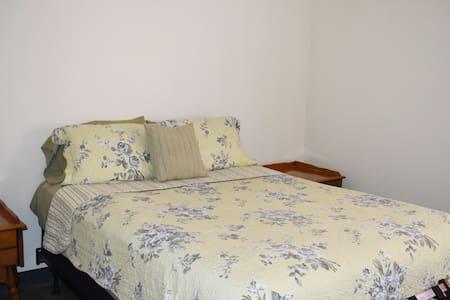 Hermann Crown Suite: Shepherd's Suite, a pet-friendly room. Queen-size bed in bedroom.