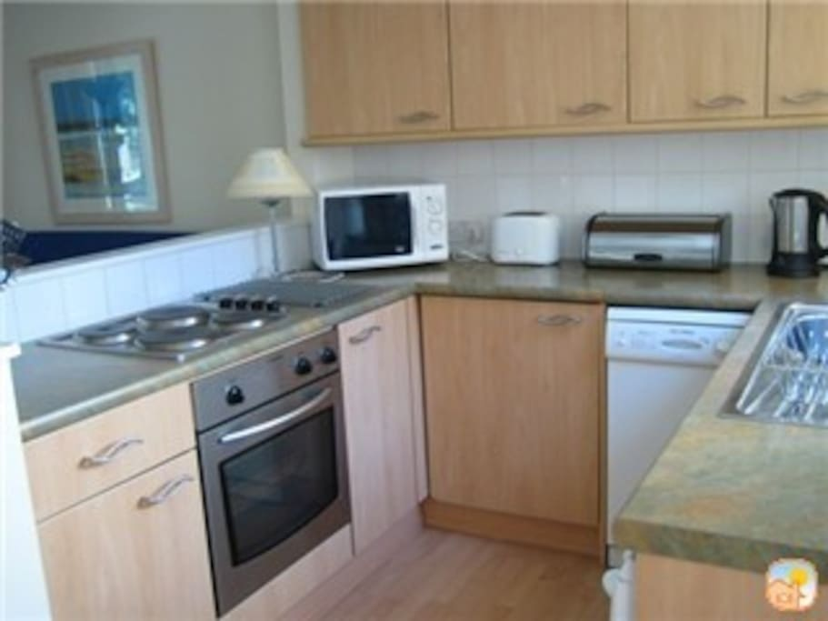 Well equipped kitchen - dishwasher, oven & halogen hob, microwave, washing machine & dryer, freezer toaster & all cleaning things. Coffee, teas, sugar, milk  to start  you off