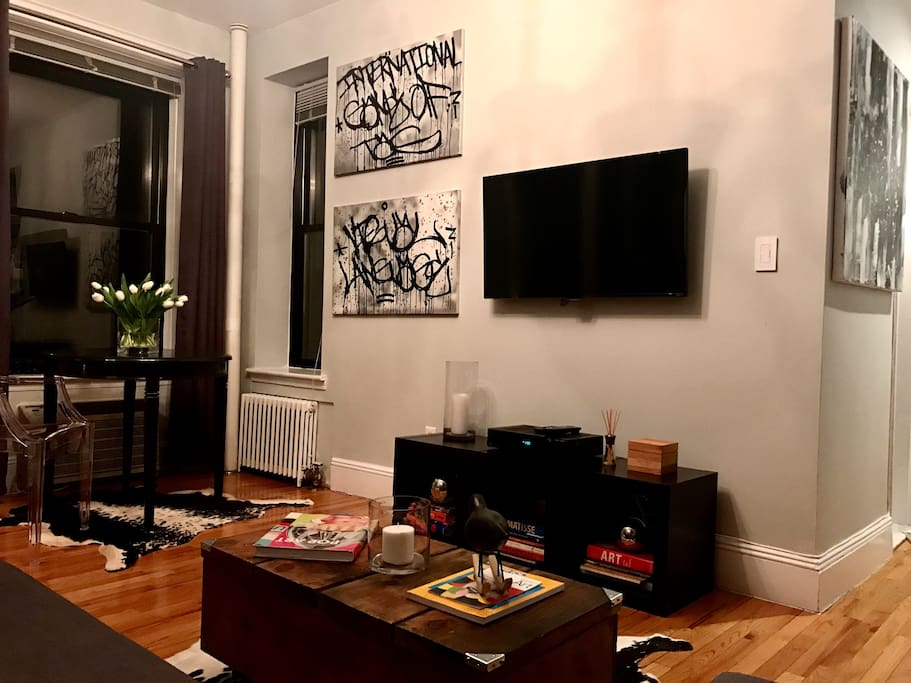 Large wall mounted TV with Netflix - Cable and WiFi.