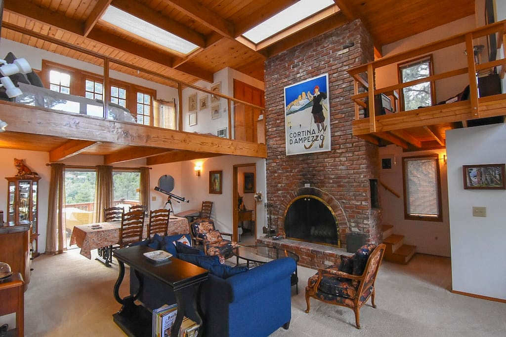 This fireplace goes three stories high!  The lower level has a fireplace too.  The brick, wood and light are all very lovely!