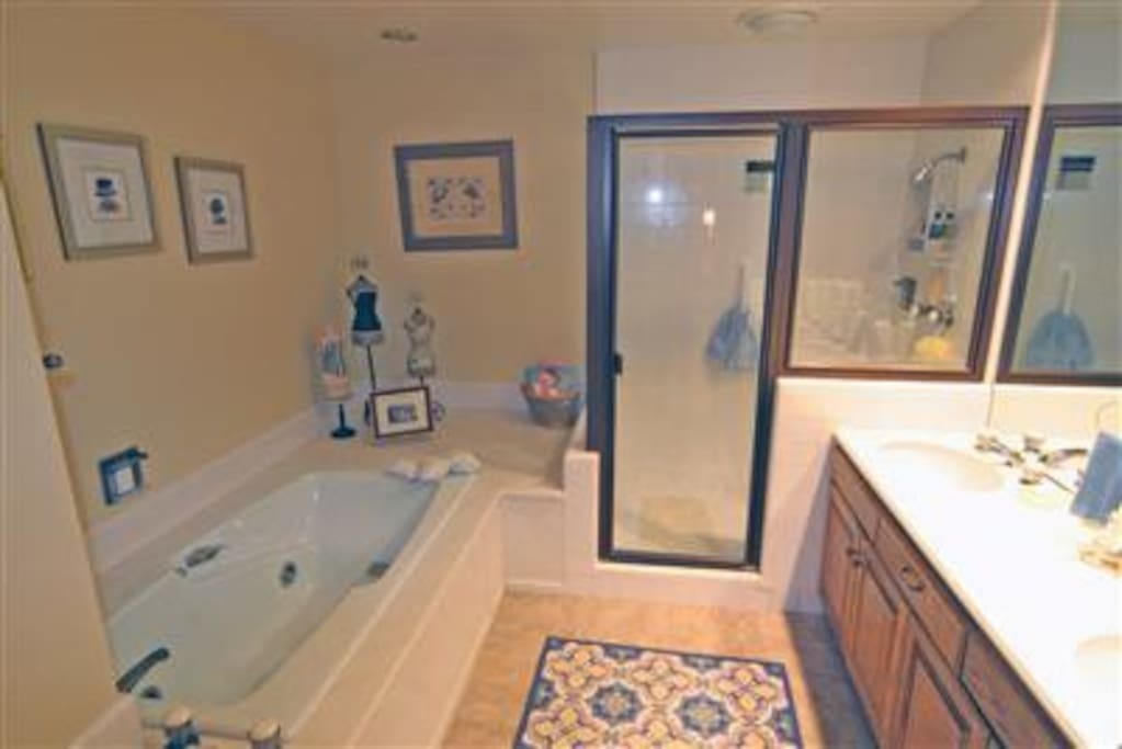 Both bathrooms have dual sinks with separate bath and showers.