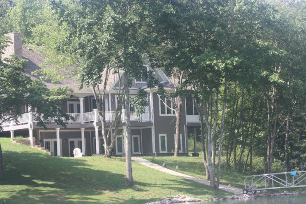 View of the house from the water. The house is right by the water with no steps to the dock!