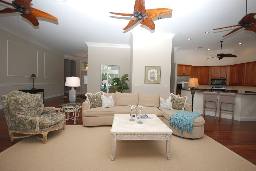 Great room with plenty of soft seating.  Arm chairs big enough for lounging.