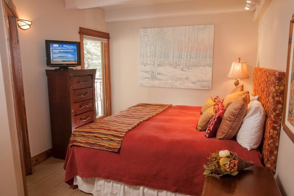 Sink into the comfortable bed in the master bedroom.