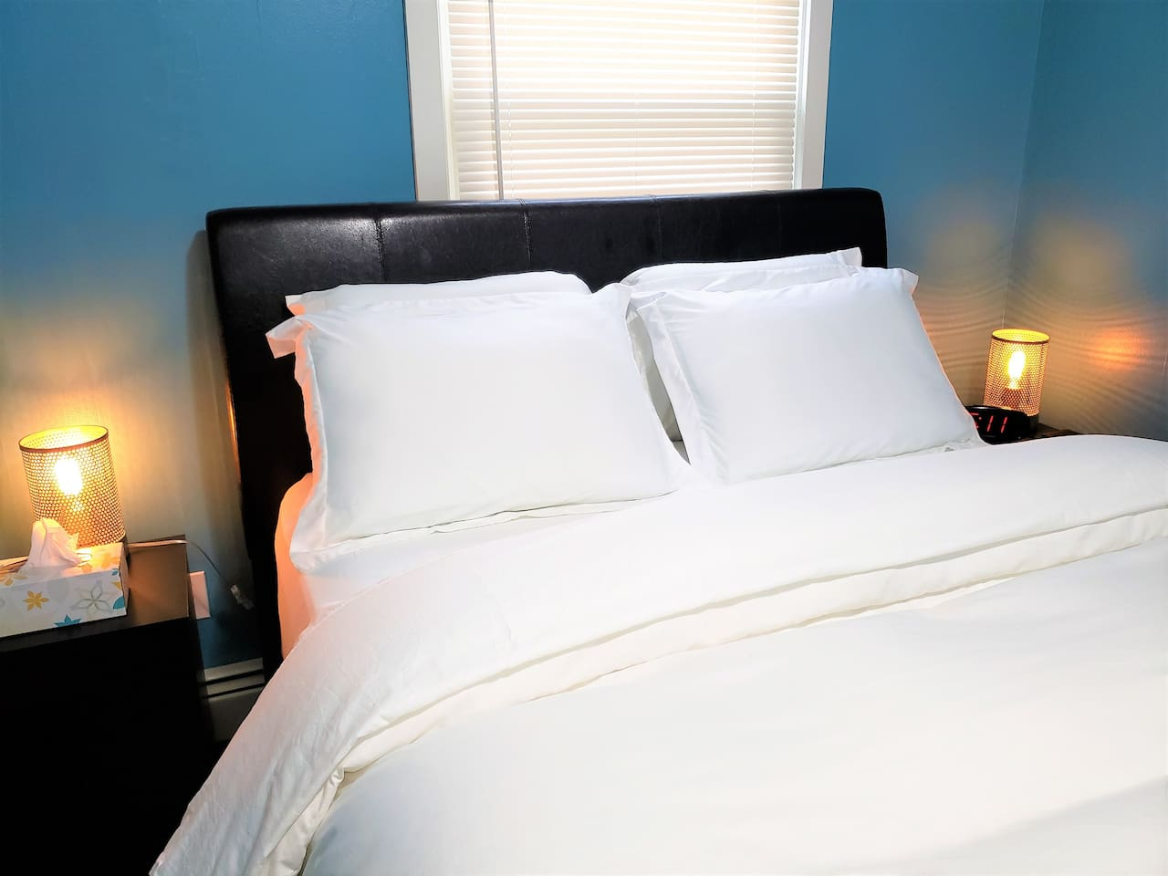 Queen bed with two foam, two medium firm pillows and a comfortable high quality comforter