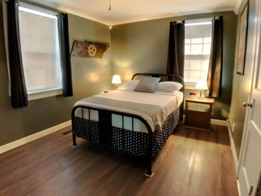 Bedroom 1 - features a double bed with his and her nightstands and lamps.  The clock has a USB charging port.