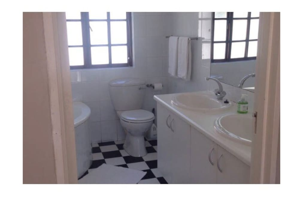 Full ensuite bathroom with shower
