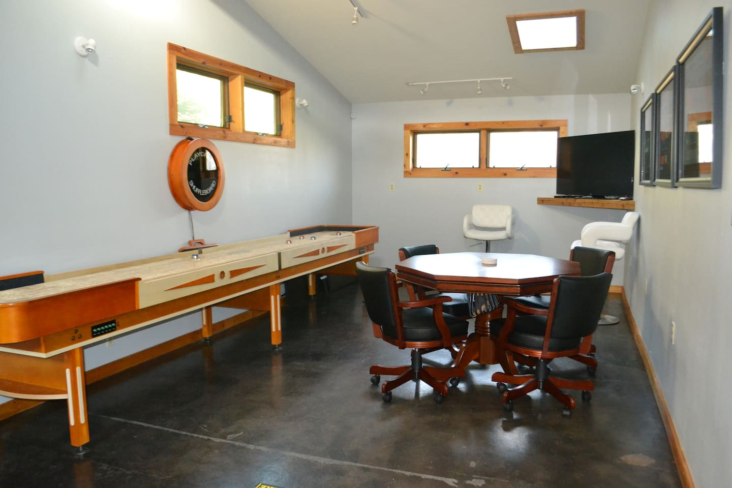 Gameroom- equipped with shuffleboard table, poker table, & darts