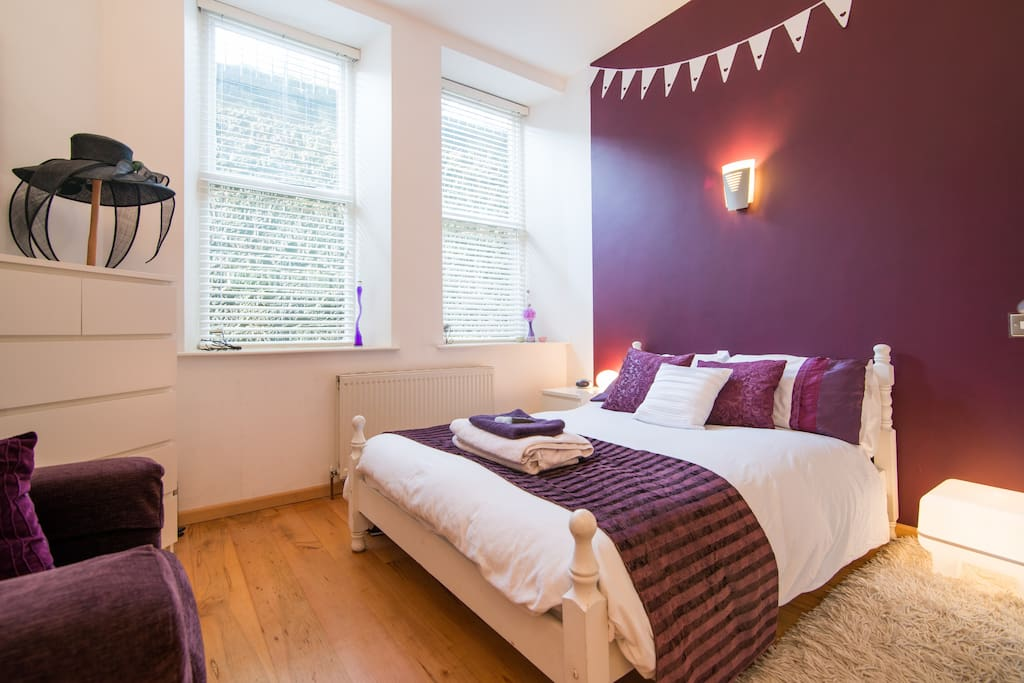 The Aubergine Room with lots of wardrobe space and big comfy bed & TV