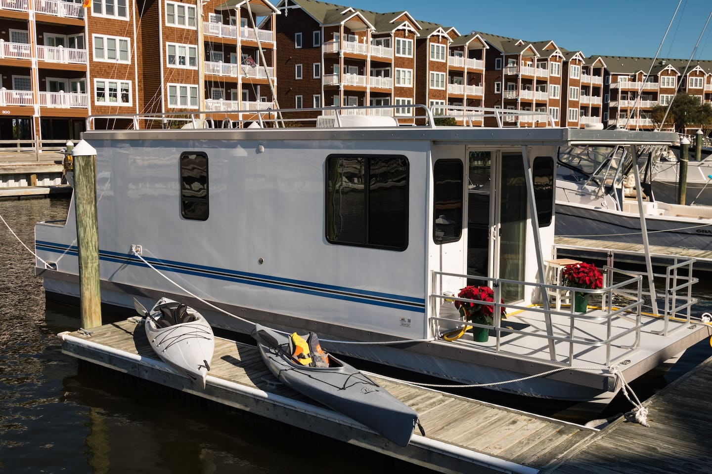 Leave from The Love Boat by water in two kayaks provided with your rental (paddles and life-vests included!)
