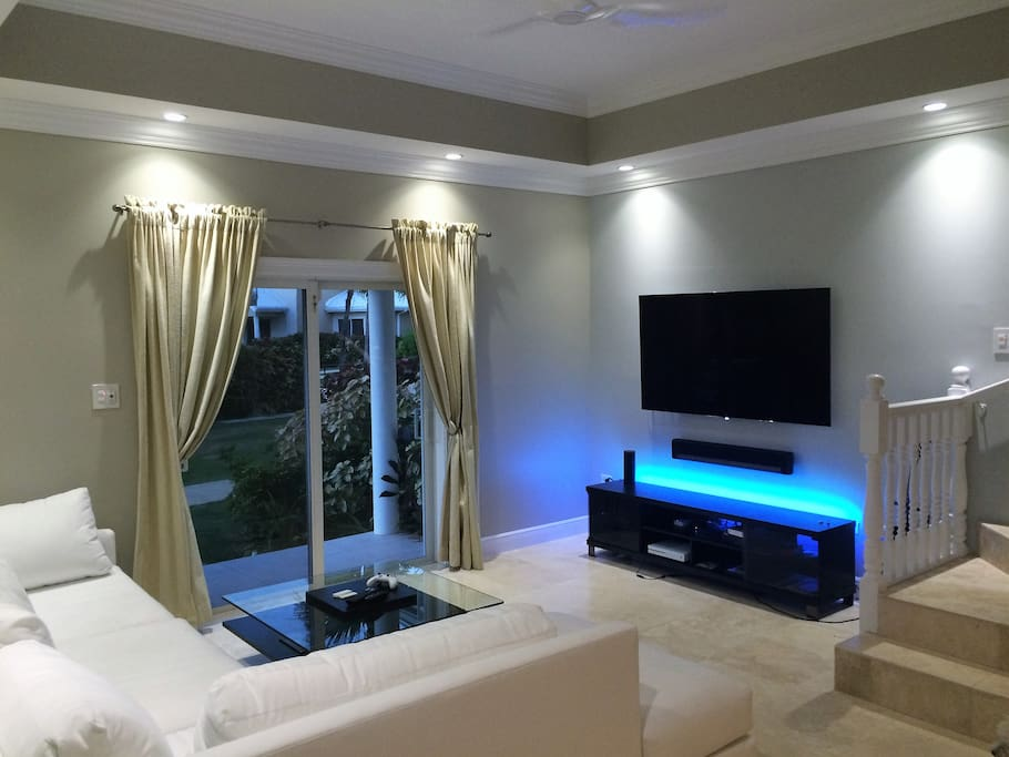 "Modern living room featuring a brand new, state of the art 65"" OLED TV by LG"