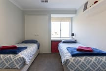 Bedroom 2 with 2 single beds