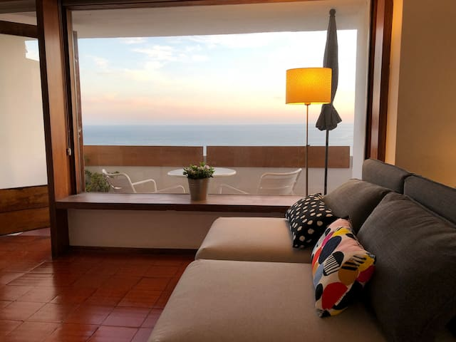 Living area and sunset view to the balcony.