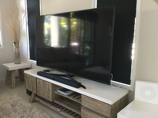 We have a 70 inch smart TV with Apple TV and Netflix  on both televisions . The second television is also a smart TV and is located in the master bedroom suite. It  also has Netflix and streaming apps