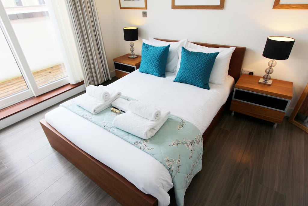 Spacious double bedroom with balcony access