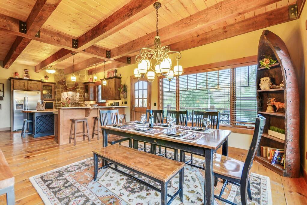 Dining Table, heated flooring, bar seating and view of Kitchen