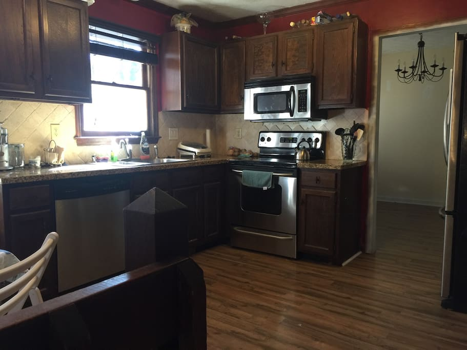 Nice open kitchen with easy to use big french door refrigerator