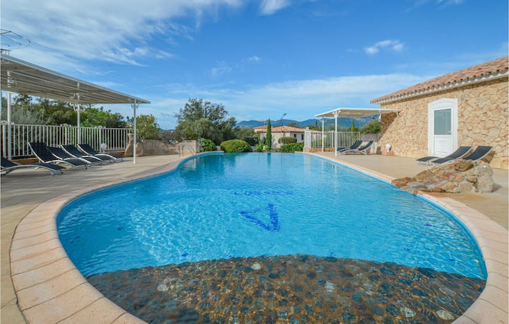 Nice home in Pinarellu with Outdoor swimming pool and 2 Bedrooms