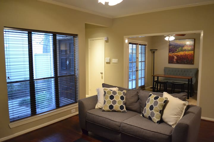 Large living room and wine/study room with a lot of natural light