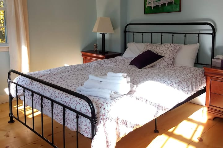 Bright and airy room with a brand new queen bed