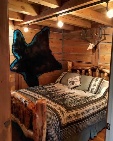 Master bedroom with queen log bed.