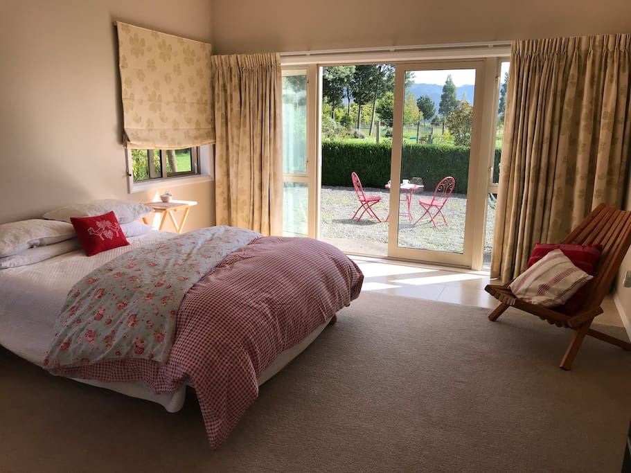Queen-size bed, French doors to patio (small step from terrace)