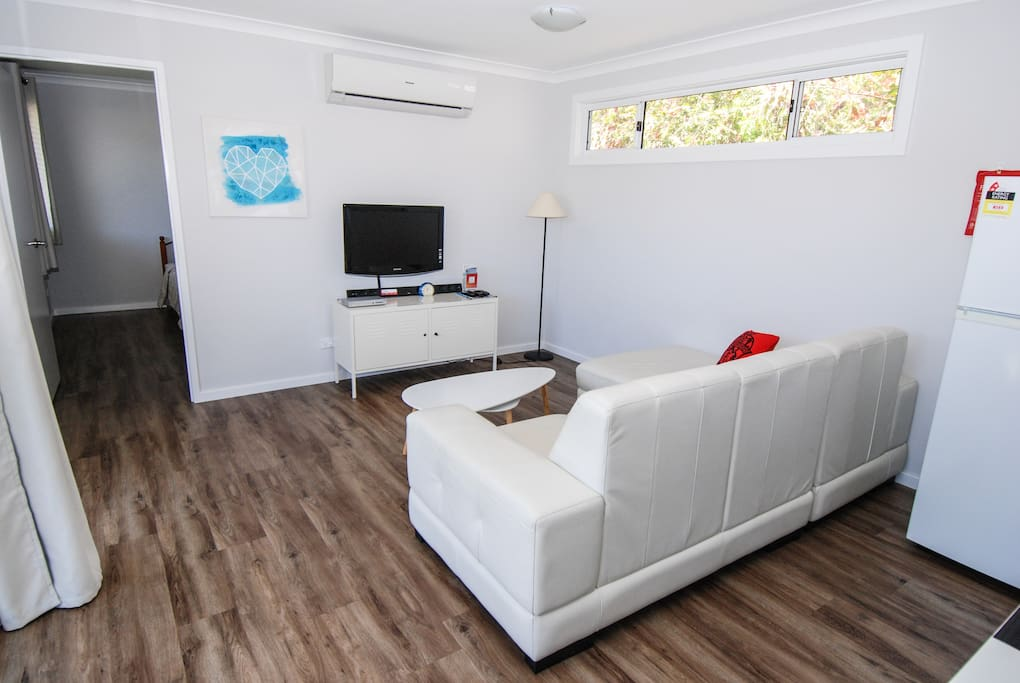 seating area with TV & reverse cycle AC