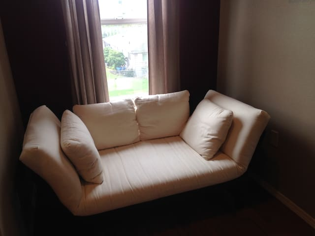 Enjoy a cup of tea and a good book in this quiet alcove. Also converts to single futon bed.