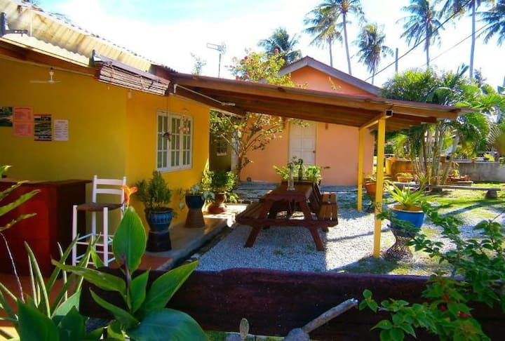 In tranquil garden setting, rustic guesthouse