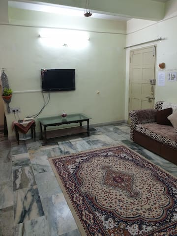 The hall is your comfort lounge with sofas to relax in and a TV for some light entertainment.