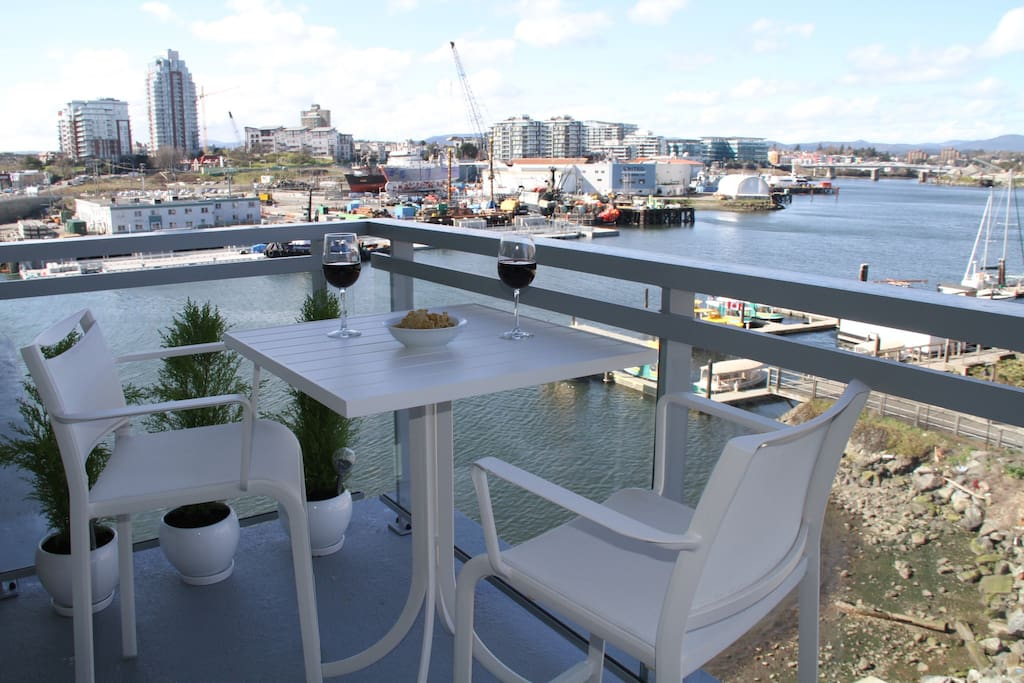 Enjoy the harbour activities from your private patio.