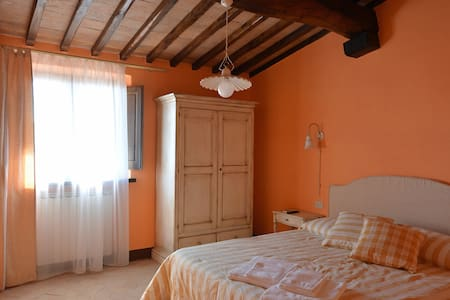 Il Ginepro camera tripla vista giardino - Montalcino - Loft