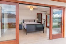 Open the doors from your master suite to the outdoors. Tropical breezes await you!