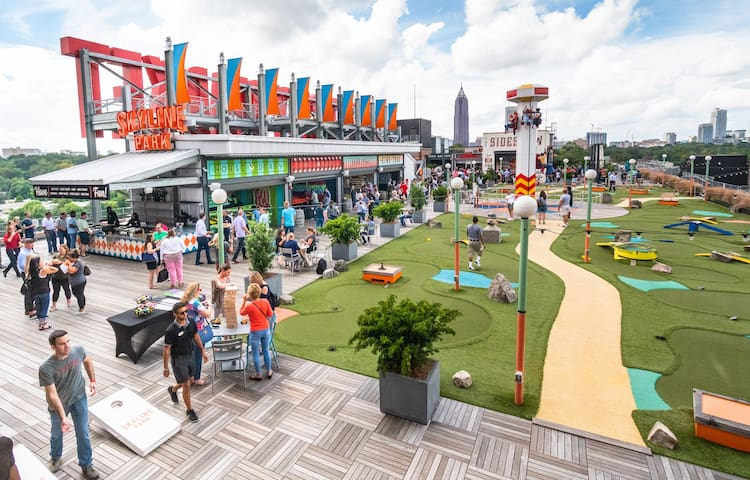 Where else can you find a rooftop amusement park with stunning skyline views? Ponce City Market!