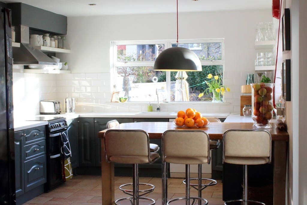 Spacious kitchen with large, american style fridge freezer, gas cooker, oven, microwave, dishwasher and washing machine.