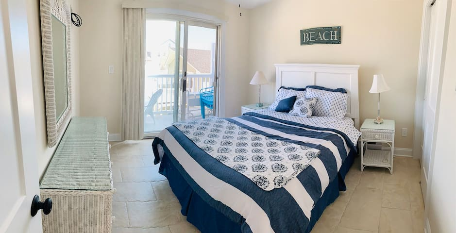 This bedroom offers a queen size bed, sliding doors to rear deck, lots of natural light. Closet features closet organizer offering lots sleeving and plenty of space for hanging your clothes.