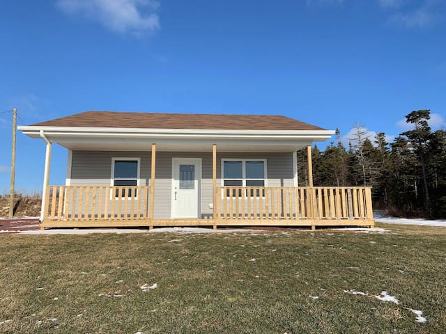 Newly built in 2018, this cottage has many features, the first of which is the spacious wrap around deck - a must have with these views!