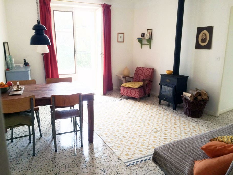 First floor: Living room, doors open to the terrace, wood stove for extra heating