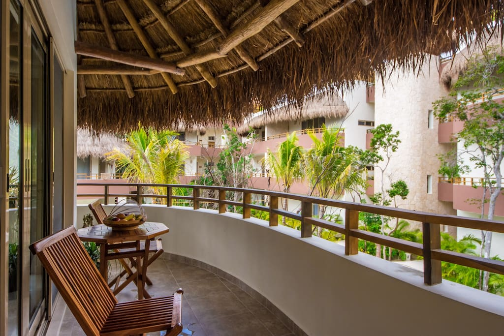 Large wraparound balcony overlooking the swimming pool is perfect for a shady breakfast or an afternoon cocktail.