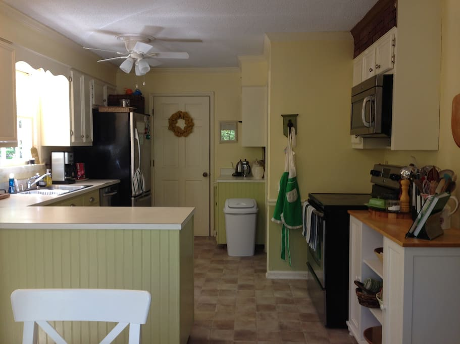 Sunny Eat-In Kitchen with Stainless Steel Appliances