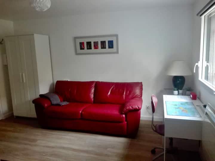 Studio en rez-de-chaussée d'une maison