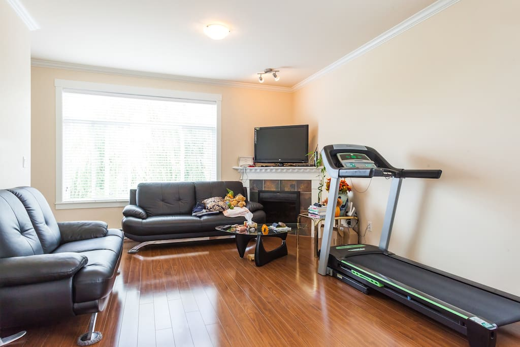 Living room with treadmill and TV