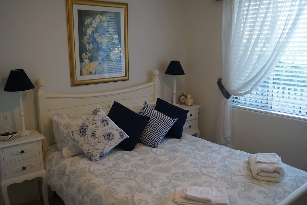Main guest bedroom. Includes flat screen TV, chest of drawers, built-in wardrobe, luggage rack.