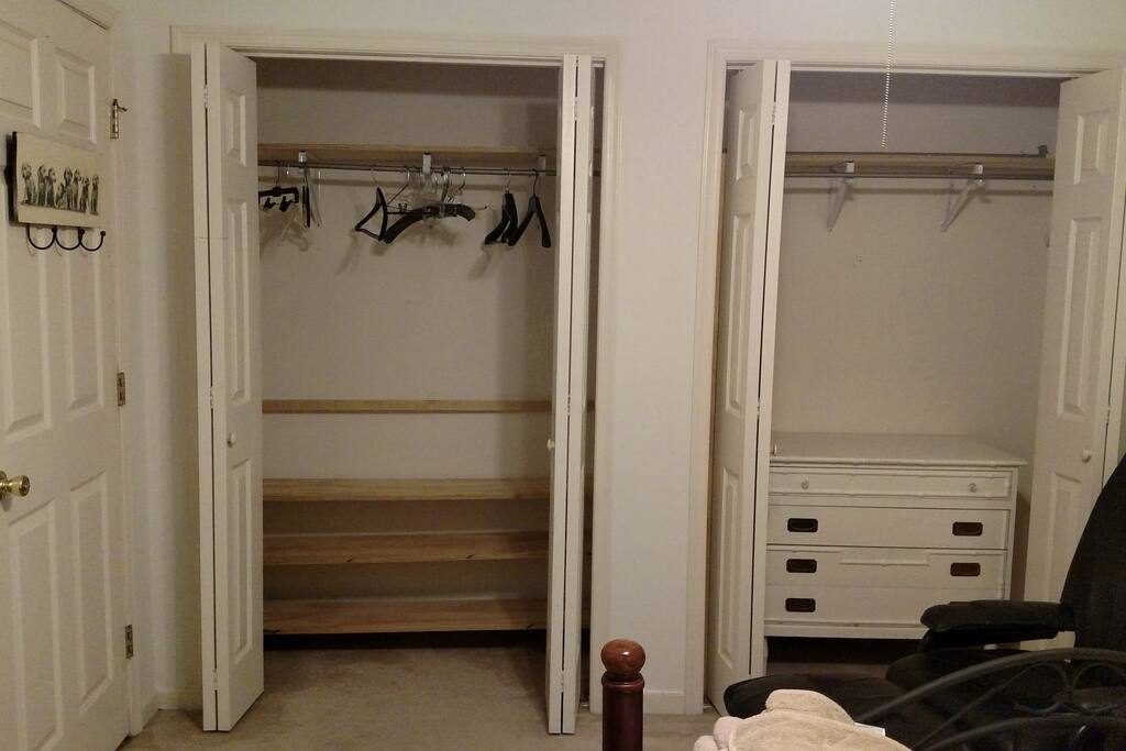 two closets, dresser, hangars, hooks on the back of the door for towels or bathrobe
