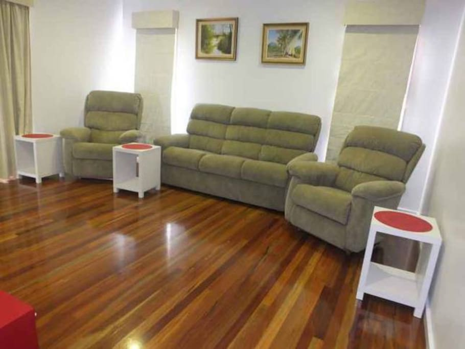Large open lounge with comfortable reclining chairs